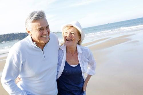 Senior couple walking on the beach in fall season-2