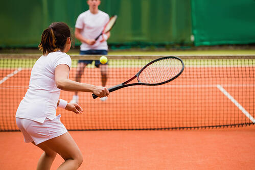 Tennis players playing a match on the court on a sunny day-1